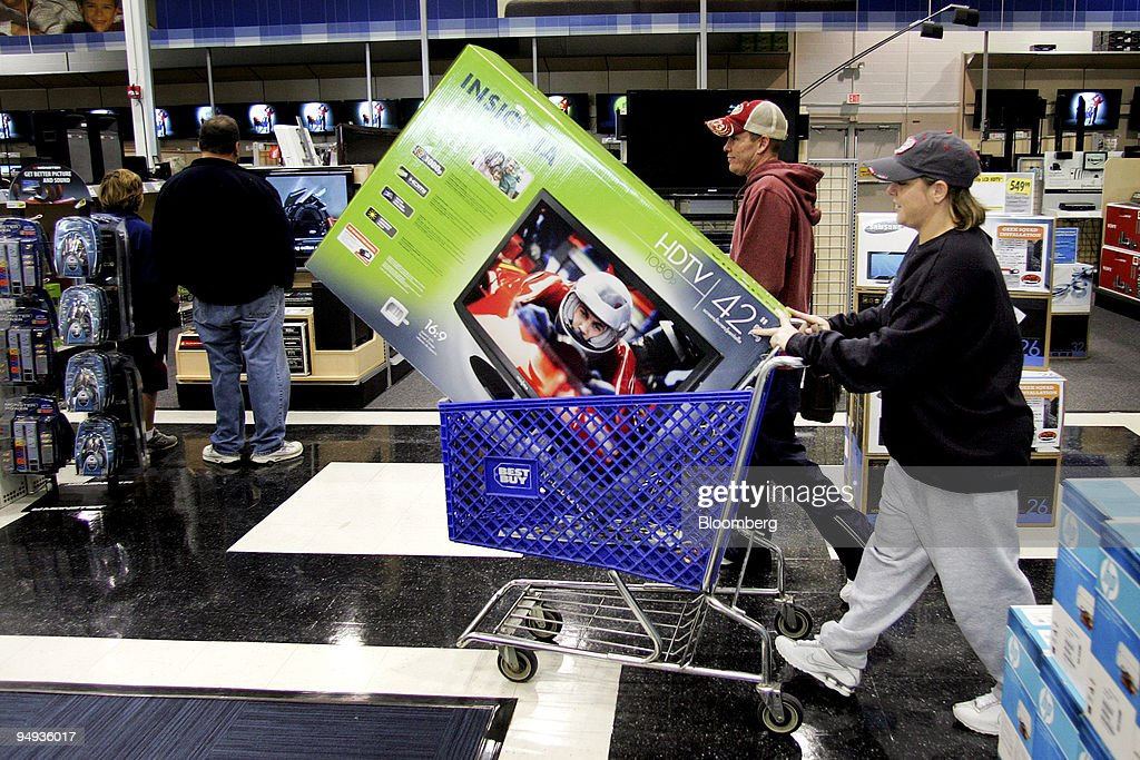 Melissa Gilmore right and Michael Maynard take their 42inch flat panel Insignia television to the checkout counter at a Best Buy store in Greensboro...