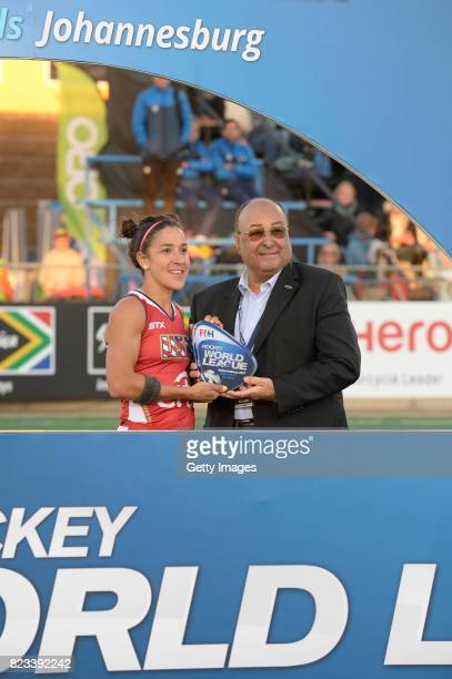 Melissa Gonzalez of United States of America receives the trophy from FIH Executive Board Member and President of the African Hockey Federation Seif...
