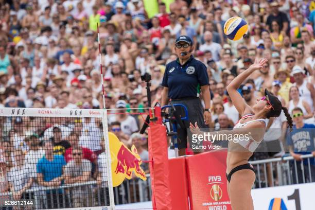 Melissa HumanaParedes of Canada spikes the ball during the broze medal match against Larissa Franca Maestrini and Talita Da Rocha Antunes of Brazil...