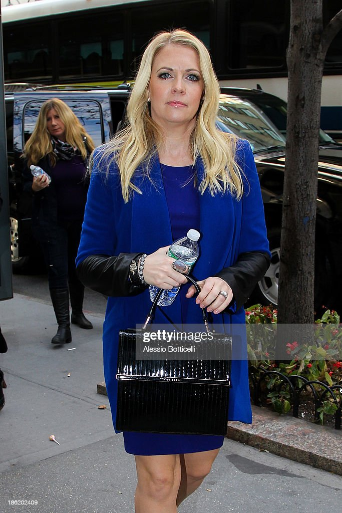 <a gi-track='captionPersonalityLinkClicked' href=/galleries/search?phrase=Melissa+Joan+Hart&family=editorial&specificpeople=204647 ng-click='$event.stopPropagation()'>Melissa Joan Hart</a> seen heading to an office building on October 29, 2013 in New York City.