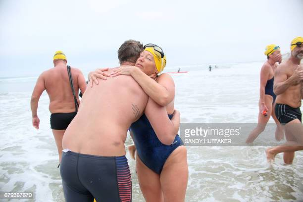 Melissa King and Ryan Nelson embrace after coming into the beach after a 10 kilometer swim which took them across the United StatesMexico border on...