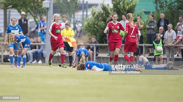 Melissa Koessler of 1 FFC Turbine Potsdam and Marlene Mueller of 1 FFC Turbine Potsdam celebrate the victory while Luisa Weber of 1899 Hoffenheim...