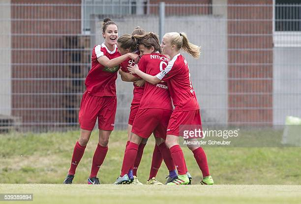 Melissa Koessler of 1 FFC Turbine Potsdam celebrates the first goal for her team with her teammates Lea Nitschke Caroline Siems Tabea Schuett and...