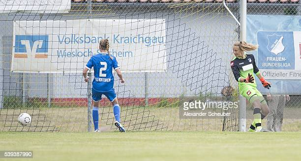 Melissa Koessler of 1 FFC Turbine Potsdam scores the first goal for her team against Janina Leitzig of 1899 Hoffenheim during the U17 girl's...