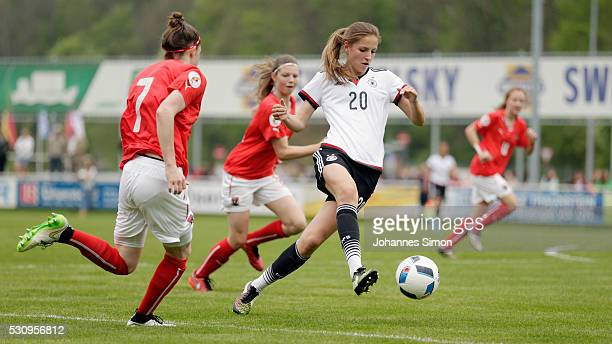 Melissa Koessler of Germany fights for the ball with Stefanie Schneeberger and Claudia Wenger of Austria during the U16 girl's international friendly...