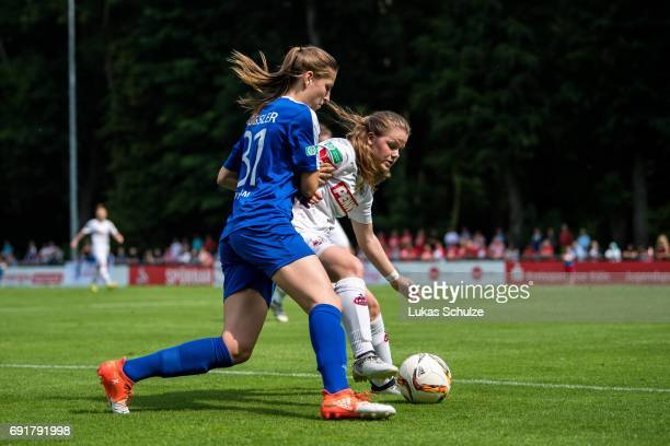 Melissa Koessler of Potsdam and Anna Grassinger of Koeln fight for the ball during the B Junior Girl's German Championship Semi Final match between 1...