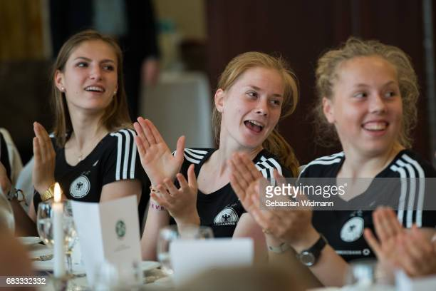 Melissa Koessler Sjoeke Nuesken and Wiebke Willebrandt laugh at the European Champion reception of the German U17 Women's team at Le Meridien Grand...