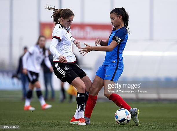 Melissa Kossler of Germany competes for the ball with Maelle Lakrar of France during the international friendly match between U17 Girl's Germany and...