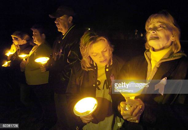 Melissa Lamb and Christine Bolin relatives of Jessica Marie Lunsford takes part in a candlelight vigil March 5 2005 in Roachester Ohio Lunsford's mom...