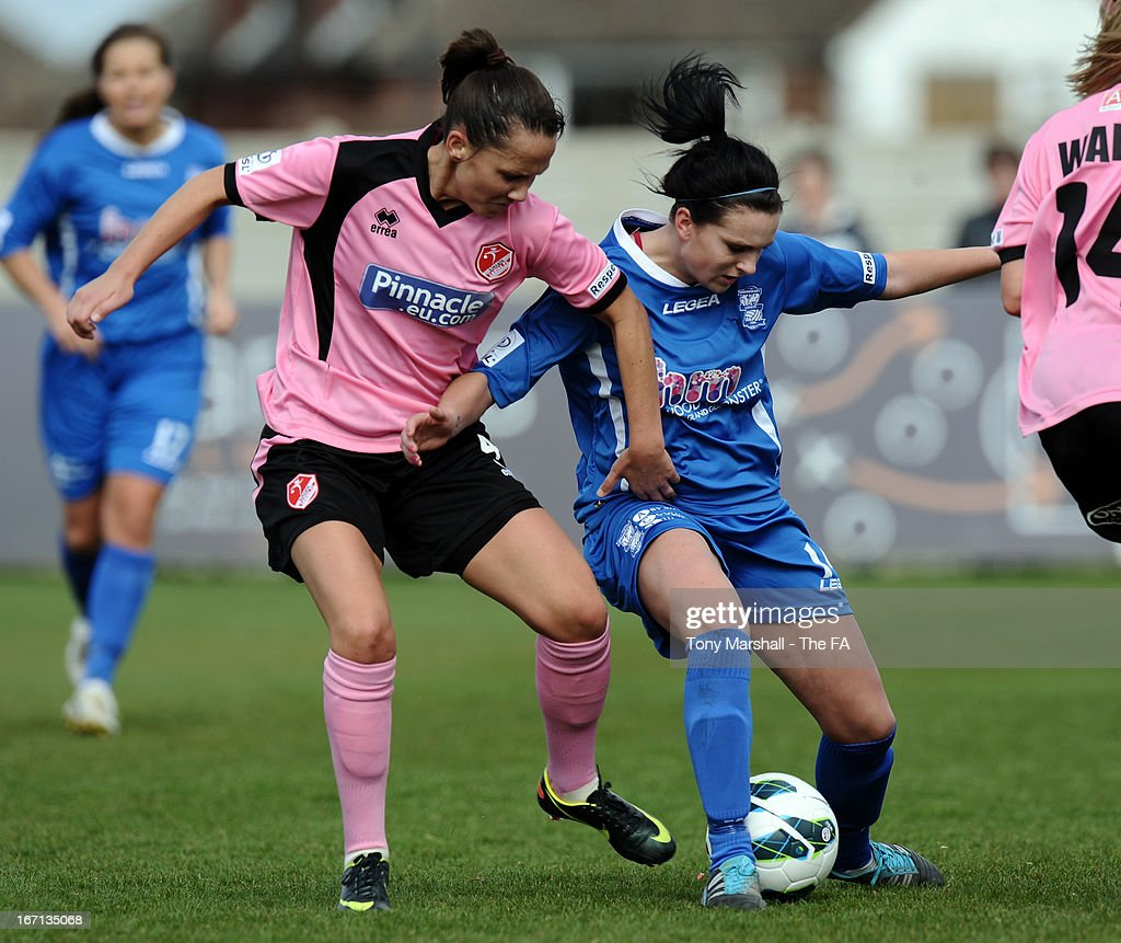 Melissa Lawley of Birmingham City (R) is tackled by Hayley Bowden of Lincoln Ladies during the FA Women's Super League match between Birmingham City Ladies FC and Lincoln Ladies FC at DCS Stadium, Stratford Town FC on April 21, 2013 in Stratford, England.