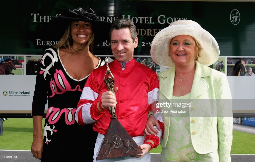 Melissa Lehman and and Glendryth Woosnam present winning jockey Michael Hills with his trophy after the third race during the Ryder Cup Wives Race...