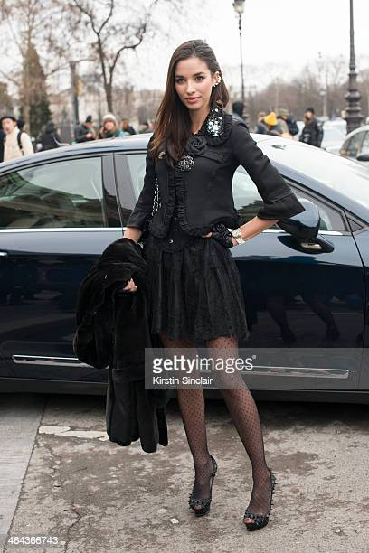 Melissa M wears Louboutin shoes and the rest is Chanel day 2 of Paris Haute Couture Fashion Week Spring/Summer 2014 on January 21 2014 in Paris France