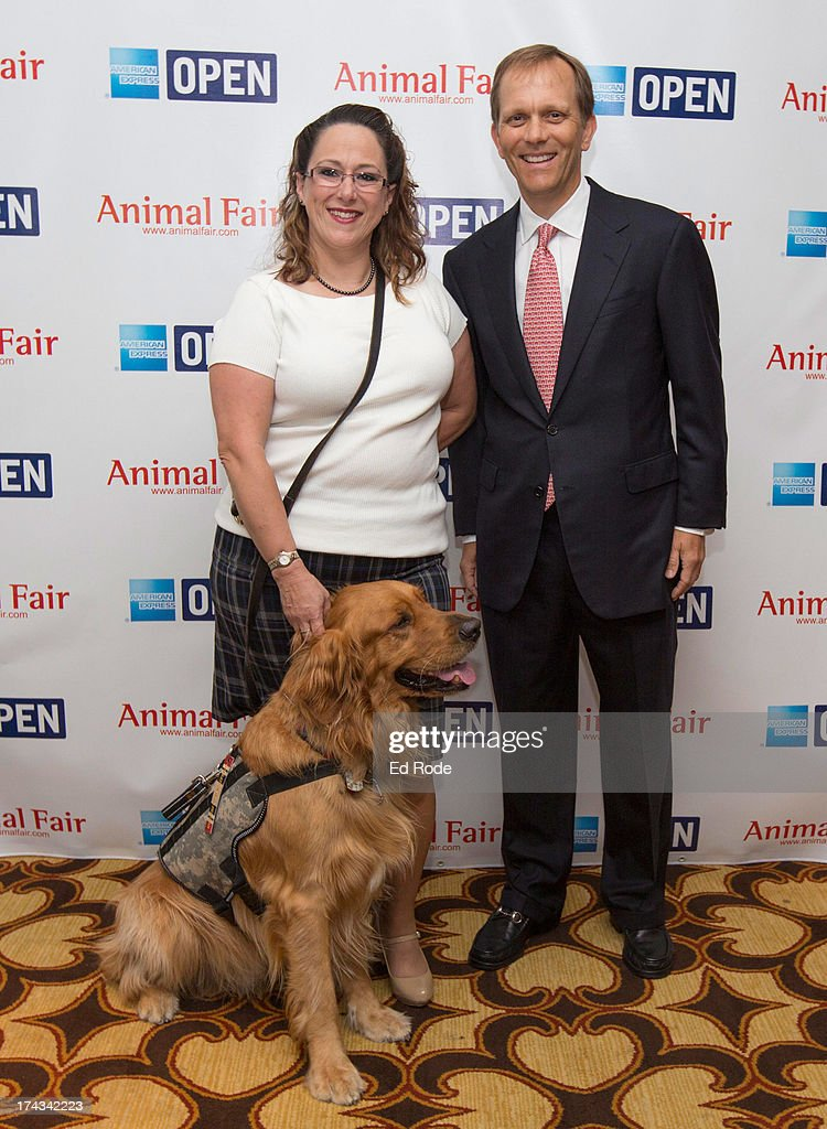 Melissa Maher, Chauncey and John Ingram attends AnimalFair.com Bark Breakfast Benefiting K9s For Warriors at the Loews Vanderbilt Hotel on July 24, 2013 in Nashville, Tennessee.