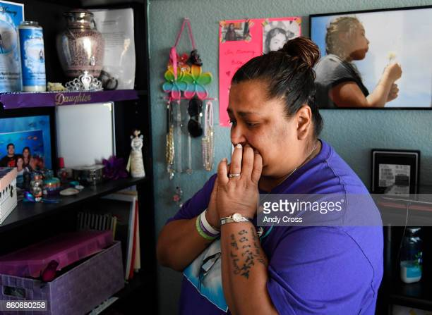 Melissa Martinez fights back tears looking at a shrine for her daughter Isabella in Isabella's room October 12 2017 Isabella Martinez committed...