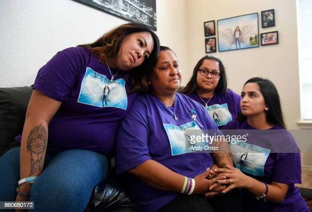 Melissa Martinez surrounded by her daughters from left Katie Olivia and Erika at the Martinez home October 12 2017 Melissa's daughter Isabella...
