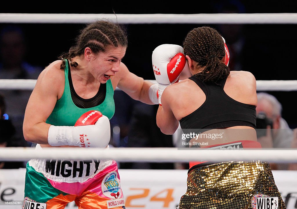 Melissa McMorrow of USA and Nadia Raoui (R) of Germany box during the WBO - WIBF Female Flyweight title fight at Getec Arena on March 23, 2013 in Magdeburg, Germany.
