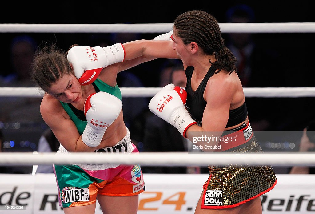 Melissa McMorrow of USA and Nadia Raoui (R) of Germany exchange punches during their WBO - WIBF Female Flyweight title fight at Getec Arena on March 23, 2013 in Magdeburg, Germany.