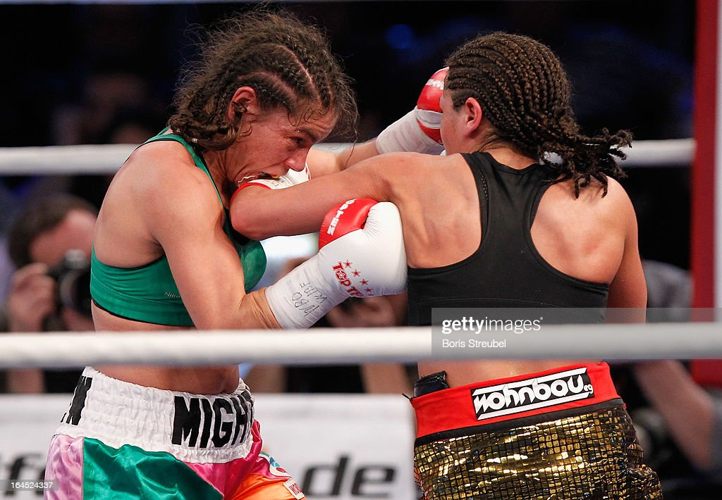 Melissa McMorrow of USA and Nadia Raoui (R) of Germany exchange punches during the WBO - WIBF Female Flyweight title fight at Getec Arena on March 23, 2013 in Magdeburg, Germany.
