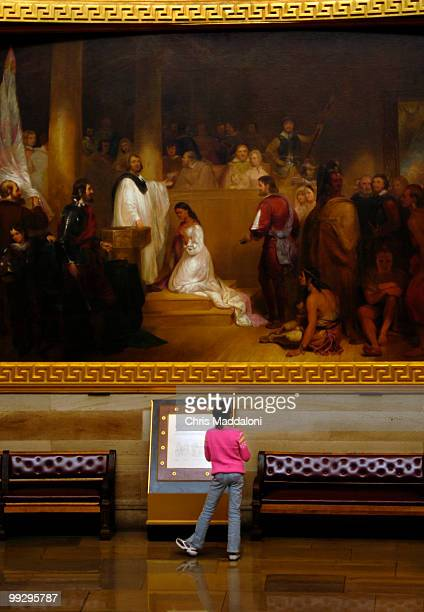 Melissa Mederos from Miami Fl looks at the Baptism of Pocahontas by John Gadsby Chapman in the Rotunda of the Capitol