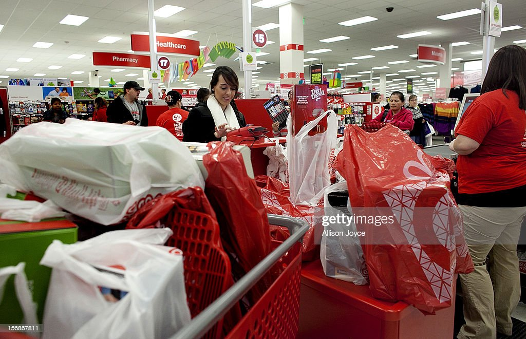 Melissa Menses pays for her purchases at checkout during Black Friday sales at Target in the South Shore Plaza on November 23, 2012 in Braintree, Massachusetts. Black Friday, the start of the holiday shopping season, has traditionally been the busiest shopping day in the United States.