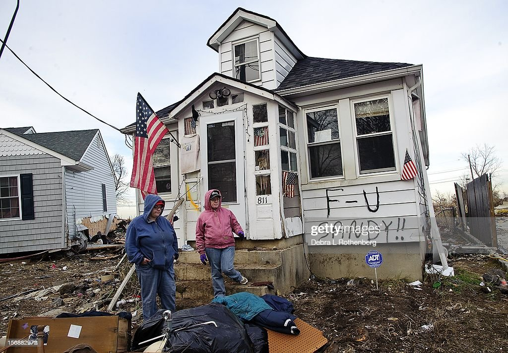Melissa Morgans-Johnston and Rebecca Sacaloff outside their home on Prospect Avenue on November 16, 2012 in Union Beach, New Jersey. Hurricane Sandy devastated this small waterfront town on October 29, 2012. Residents who lived near the water were allowed back into town 3 days ago, only to find many of their homes are either gone or condemned.