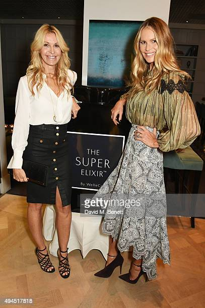 Melissa Odabash and Elle Macpherson attend The Super Elixir 1st anniversary dinner at The Grace Restaurant at Grace Belgravia on October 27 2015 in...