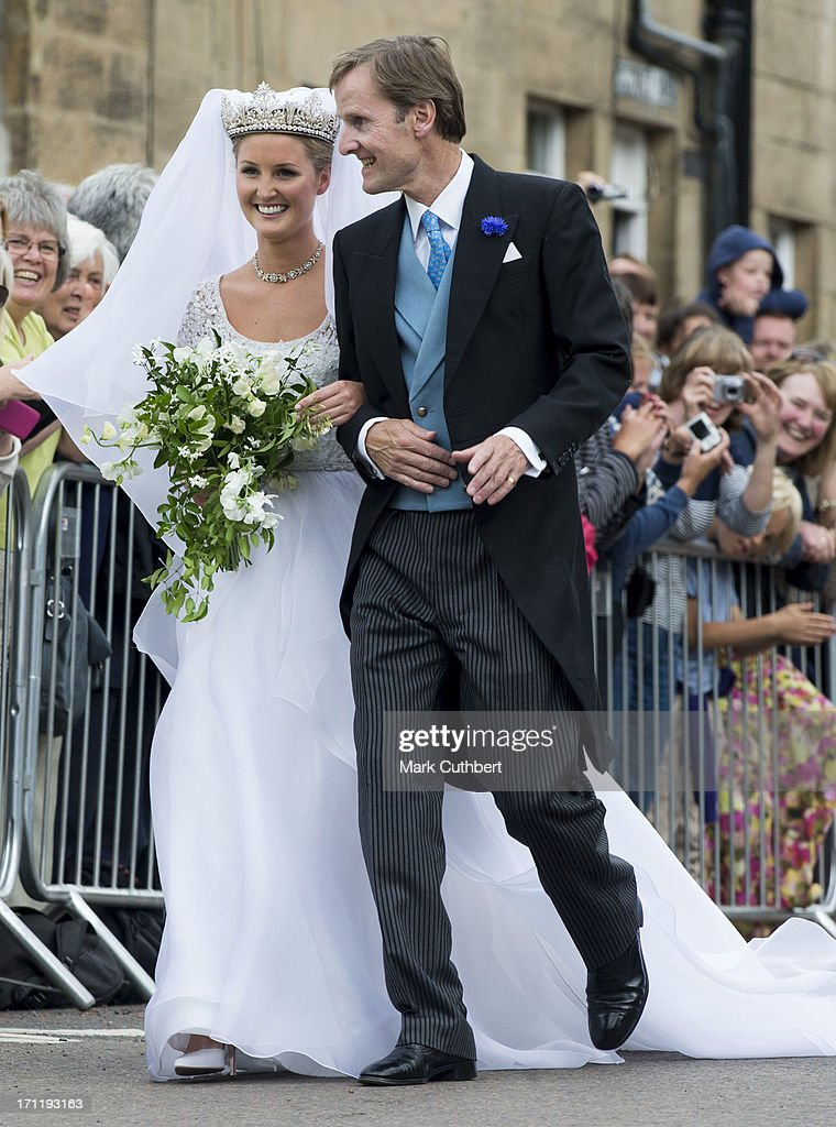 Melissa Percy with her father Ralph Percy, Duke of Northumberland on her way to her wedding with Thomas van Straubenzee at Alnwick Castle on June 22, 2013 in Alnwick, England.