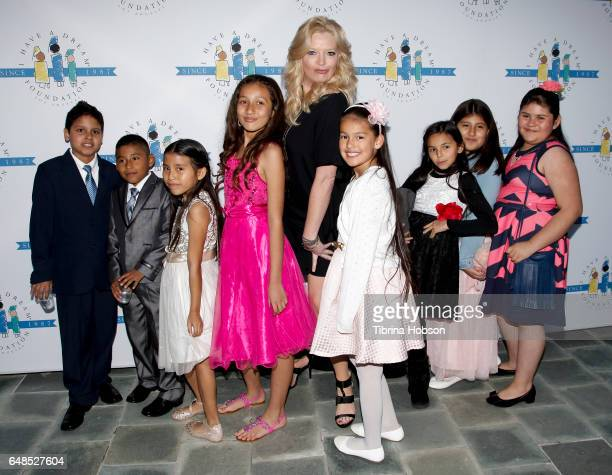 Melissa Peterman and the children of 'I have a Dream' Foundation attend the 'I Have A Dream' Foundation Annual Dreamer Dinner at Skirball Cultural...