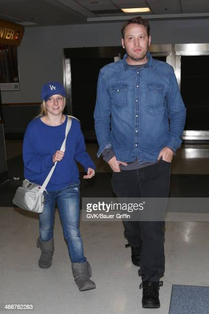 Melissa Rauch and her husband Winston Beigel are seen at LAX airport on February 03 2014 in Los Angeles California