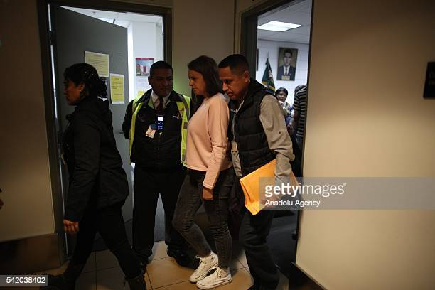 Melissa Reid of Britain is escorted by police officers before boarding a flight in Lima Peru Tuesday June 21 2016 Reid was deported from Peru along...