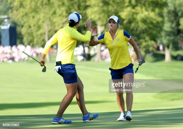 Melissa Reid of England and the European Team celebrates after she holed a birdie putt at the 16th hole with her parner Carlota Ciganda of Spain in...
