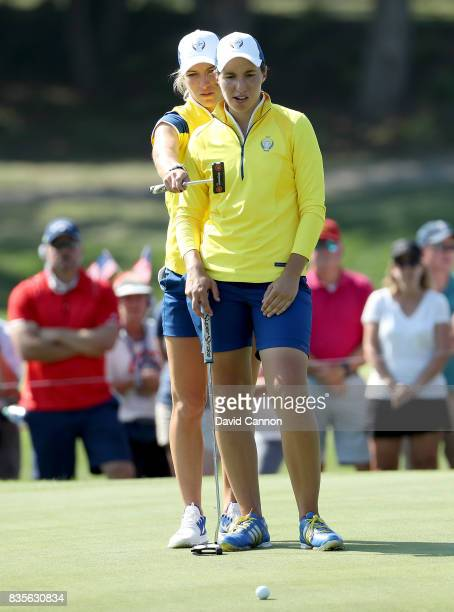 Melissa Reid of England and the European Team lines up a putt at the 15th hole with her partner Carlota Ciganda of Spain in their match against...