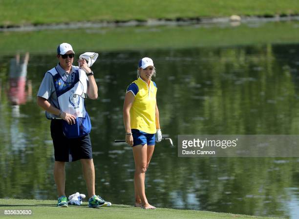 Melissa Reid of England and the European Team removes her shoes and socks for her second shot at the 11th hole in her match with Carlota Ciganda...