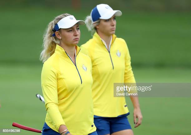 Melissa Reid of England and the European Team walks with Emily Pedersen of Denmark on the second hole in their match against Paula Creamer and Austin...