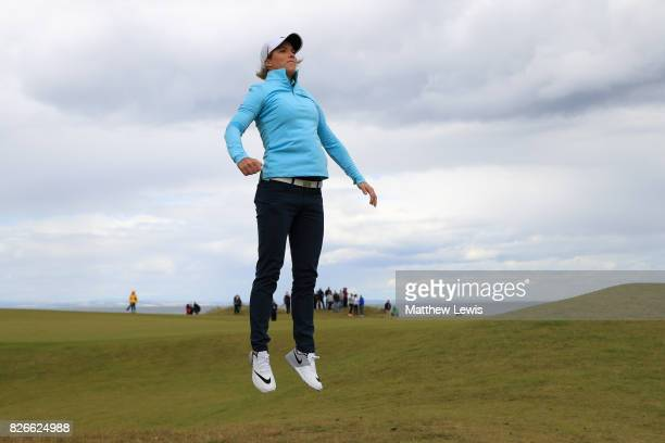 Melissa Reid of England jumps to see down the 4th hole during the third round of the Ricoh Women's British Open at Kingsbarns Golf Links on August 5...