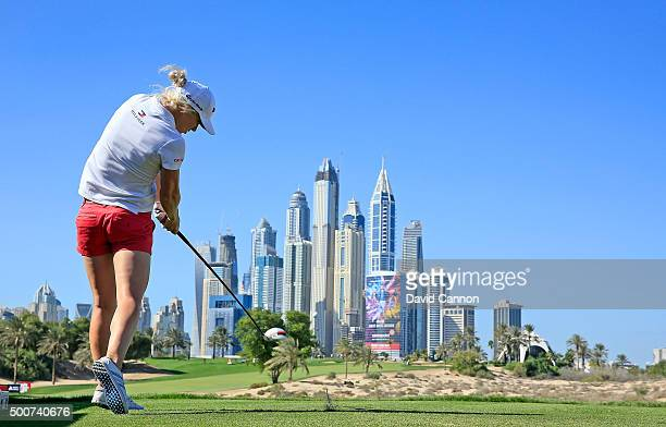 Melissa Reid of England plays her tee shot on the par 4 eighth hole during the second round of the 2015 Omega Dubai Ladies Masters on the Majlis...