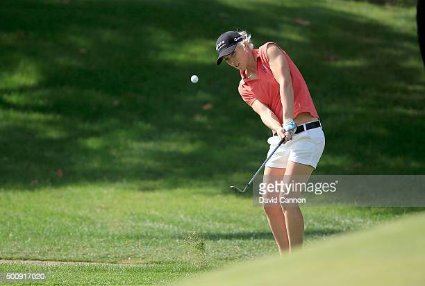 Melissa Reid of England plays her third shot on the par 4 first hole during the third round of the 2015 Omega Dubai Ladies Masters on the Majlis...