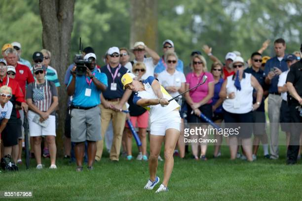 Melissa Reid of England the European Team hits her second shot on the par 4 12th hole in her match with Charley Hull against Cristie Kerr and Lexi...