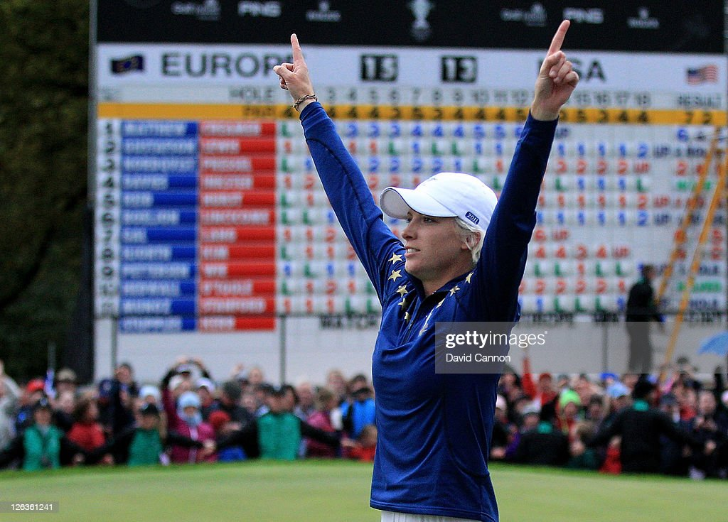 <a gi-track='captionPersonalityLinkClicked' href=/galleries/search?phrase=Melissa+Reid&family=editorial&specificpeople=807482 ng-click='$event.stopPropagation()'>Melissa Reid</a> of Europe celebrates her team's 15-13 victory on the 18th green during the singles matches on day three of the 2011 Solheim Cup at Killeen Castle Golf Club on September 25, 2011 in Dunshaughlin, County Meath, Ireland.