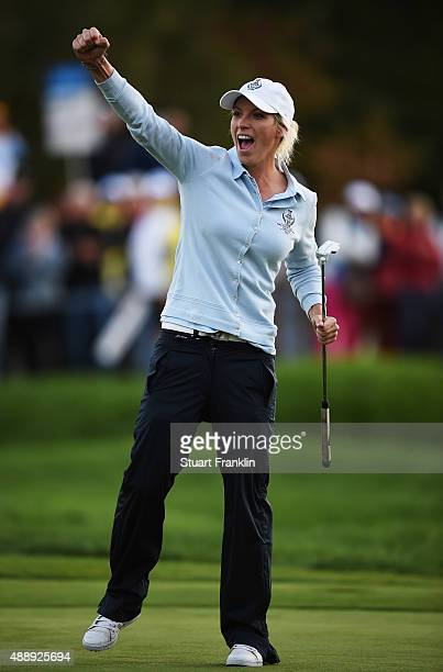 Melissa Reid of team Europe celebrates holeing her putt on the 16th hole during the afternoon fourball matches at The Solheim Cup at St LeonRot Golf...