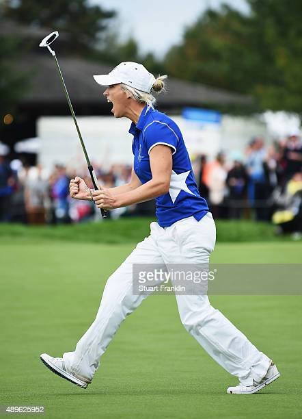 Melissa Reid of team Europe celebrates winning her match during the singles matches of The Solheim Cup at St LeonRot Golf Club on September 20 2015...