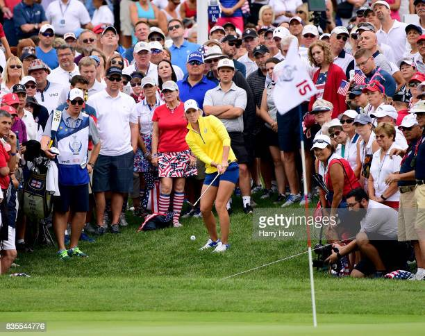 Melissa Reid of Team Europe hits out of the rough on the 15th green losing to Team USA five and three during the morning foursomes matches of the...