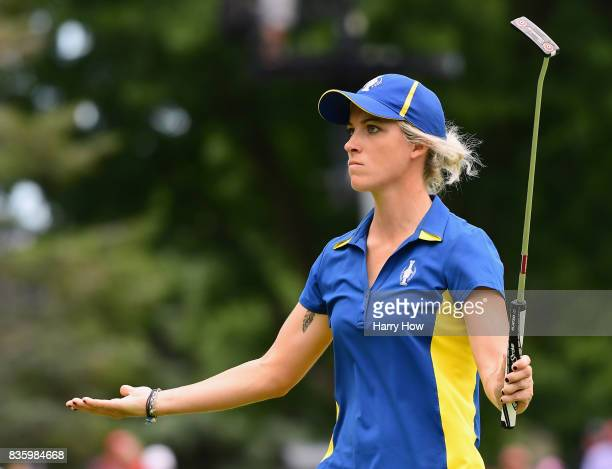Melissa Reid of Team Europe reacts to her birdie putt on the 16th green in her match against Cristie Kerr of Team USA during the final day singles...