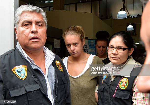 Melissa Reid the British youth arrested on August 6 2013 at Lima's airport carrying cocaine in her luggage is escorted out of the Callao prosecutors...