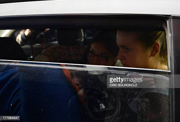 Melissa Reid the British youth arrested on August 6 2013 at Lima's airport carrying cocaine in her luggage sits in a car outside the Callao...