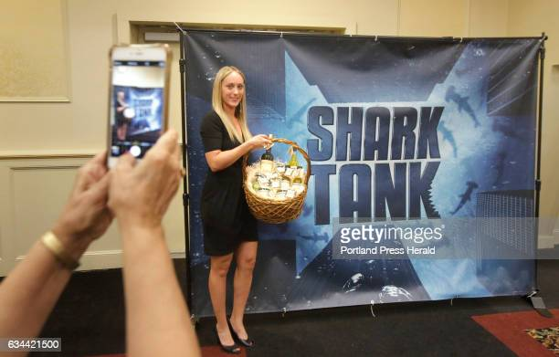 Melissa Rioux of Saco poses for a photo at a Shark Tank poster taken by her mother Daphne Rioux after the two made their pitch at the Shark Tank...