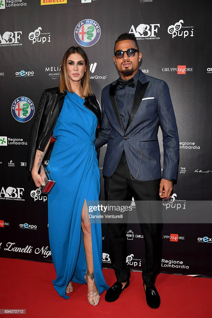 Melissa Satta and Kevin-Prince Boateng walk the red carpet of Bocelli and Zanetti Night on May 25, 2016 in Rho, Italy.