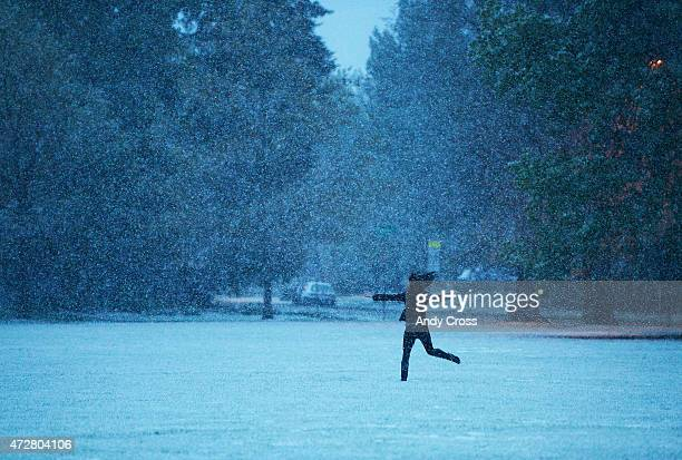 Melissa Schafer decided to have her friend stop their car along Iliff Ave and hop out to dance in the heavy snowfall at Observatory Park near...