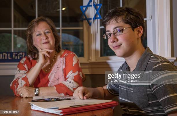 Melissa Sporn and her son Eli a sophomore at McLean High School at home in their kitchen in McLean Virginia November 21 2017 A religious interfaith...