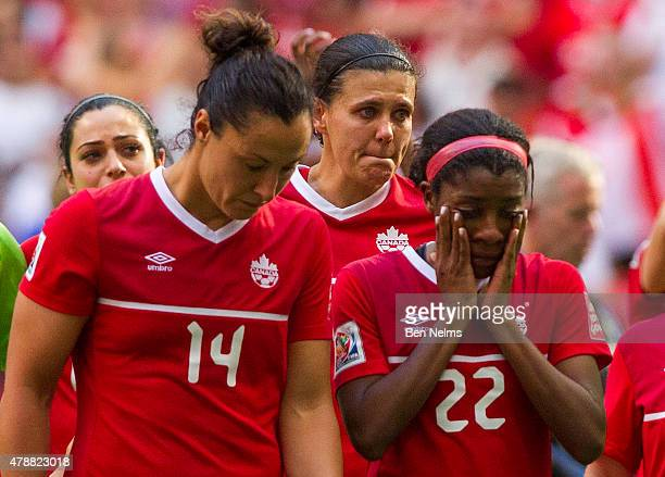 Melissa Tancredi Christine Sinclair and Ashley Lawrence of Canada react after losing to England during the FIFA Women's World Cup Canada 2015 Quarter...